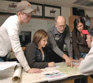 Sustainability western faculty resources website photo of students looking at a map with a faculty memeber thecheapjerseys Images